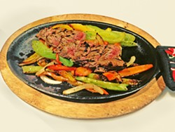 ORDER UP At La Esquina, beef is always aged in-house for three months and cooked to order. That means you can order these flavorful fajitas bloody, pink in the middle, or charred all over. - PHOTO COURTESY OF LA ESQUINA