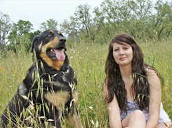 MAN'S BEST FRIEND Amber Davis said that while her CASA mentor was her savior, her dog Capone really helped her through the toughest times in her life. - PHOTO COURTESY OF AMBER DAVIS