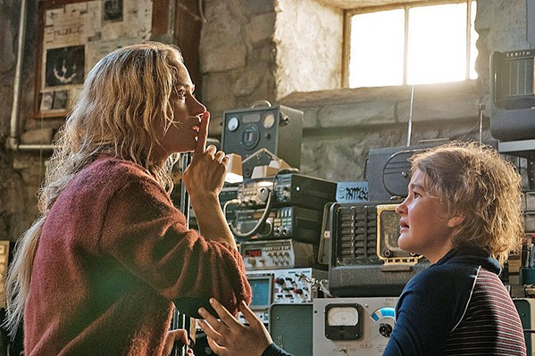 DON'T MAKE A SOUND Evelyn Abbott (Emily Blunt, left) signals to her deaf daughter Regan (Millicent Simmonds, a deaf actor) to be quiet lest a creature that hunts by sound discovers them. - PHOTO COURTESY OF PARAMOUNT PICTURES