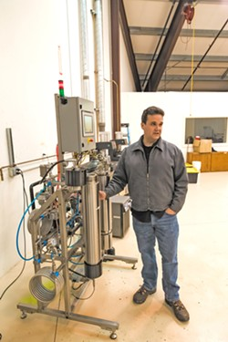 EXTRACTING CANNABIS OIL Cannabis entrepreneur Jason Kallen stands next to his carbon-dioxide extractor machine at a warehouse off Tank Farm Road. - PHOTO BY JAYSON MELLOM