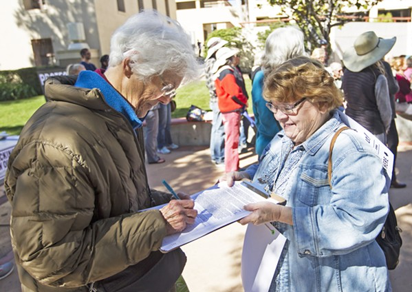 GET OIL OUT Petitioners kicked off a ballot initiative in February to ban new oil wells, hydraulic fracturing, and other intense oil extraction techniques. On May 1, activists delivered 20,000 signatures to the county. - FILE PHOTO BY JAYSON MELLOM