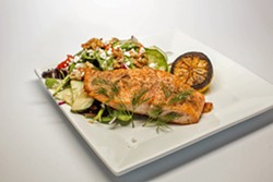 UP STREAM Simple, classic grilled salmon is served alongside a bed of greens topped with walnuts and honey mustard vinaigrette. - PHOTO COURTESY OF BY MELISSA MATTSON
