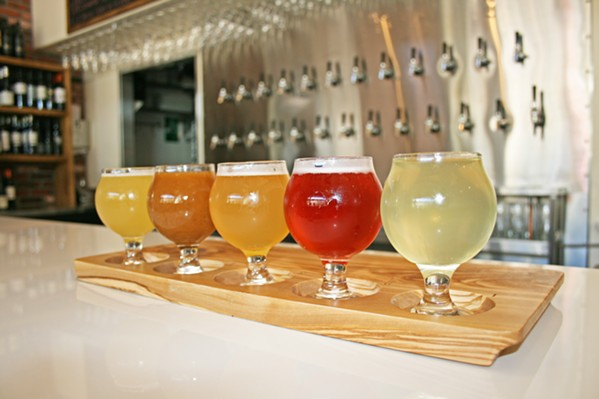 FRESH PICKED Sip a colorful, crisp tasting flight of unique fruit ciders at Cider Bar, located within the revamped Creamery in SLO. From left to right, Farmhouse kiwi, strawberry, white peach, pluot, and Asian pear, all fermented by Cider Bar owner Kevin Mclaughlin. - PHOTO BY HAYLEY THOMAS CAIN