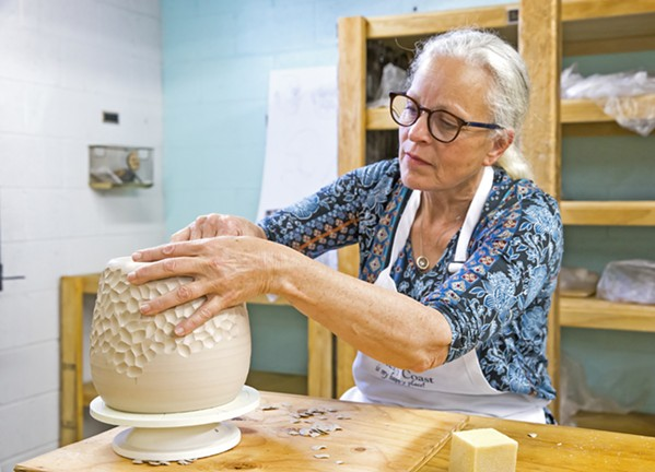 """CREATE Carrie Whitaker works on shaping and molding a piece during a class or """"tribe"""" at Pottery Coast in Grover Beach. - PHOTO BY JAYSON MELLOM"""