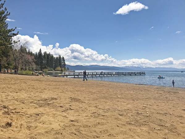 THE BEACH Though it's not the ocean, Kings Beach in Lake Tahoe does have the requisite sand and water needed for summer fun. - PHOTO BY RYAH COOLEY