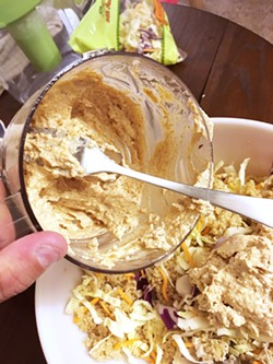 DRESSING THE QUINOA This quinoa vegetable bowl recipe called for an interesting almond butter, ginger, garlic, and lime dressing that turned out delicious. But it looks like hummus. - PHOTO BY PETER JOHNSON