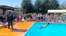 TOP FLOPPER Kids compete for the best belly flop, with the crowd applause-o-meter deciding the winner. - PHOTO BY GLEN STARKEY