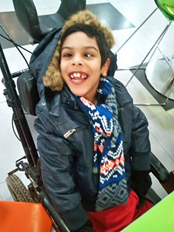 SENDING AID Nizar Khalid is a 9-year-old boy living with seizures, cerebral palsy, and scoliosis with limited access to health care. - PHOTO COURTESY OF SENECA JOHNSON