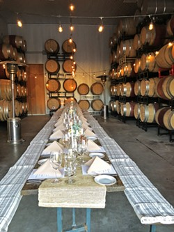 ALL THIS CAME FROM A TRUCK? The Truck's first event showed just what a mobile catering service can do. The five-course, sit-down dinner served at Clos Solène winery in Paso Robles featured a rustic barn, fine linens, and table service. - PHOTO COURTESY OF CAROLE MACDONAL