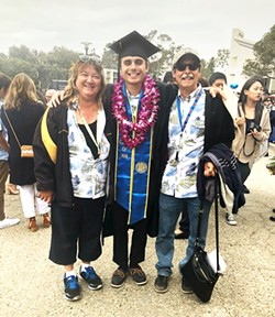 POMP AND CIRCUMSTANCE The weekend kicks off with my brother's graduation ceremony. Here he is sandwiched between my parents (notice their adorable, matching shirts). - PHOTO BY CALEB WISEBLOOD