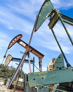HYDROCARBON LIFELINE Pump-jacks pull oil and water out of the Arroyo Grande oil field in Price Canyon. Sentinel Peak Resources, the field's operator, says an initiative on the November ballot threatens its future there. - PHOTO BY JAYSON MELLOM