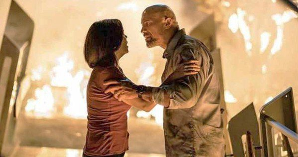 ON FIRE In Skyscraper, Will Ford (Dwayne Johnson) is framed for arson and must clear his name and rescue his family. - PHOTO COURTESY OF UNIVERSAL PICTURES