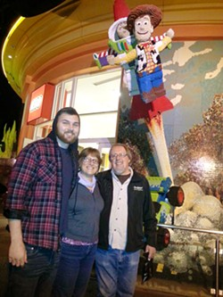 IN RECOVERY Kim Lacey (center) with her son Ty (left) and her husband, Dan Grahm, at Downtown Disney months before Ty died from a heroin overdose in 2016. - PHOTO COURTESY OF KIM LACEY