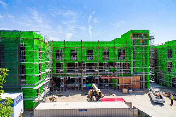 BUILT ENVIRONMENT The Chinatown development project between Palm and Monterey streets in downtown San Luis Obispo has been in the works since 2007, was approved in 2009, and has been under construction since 2015. The development will include 16 condos, a 78-room hotel, and restaurant and retail space. - PHOTO BY JAYSON MELLOM