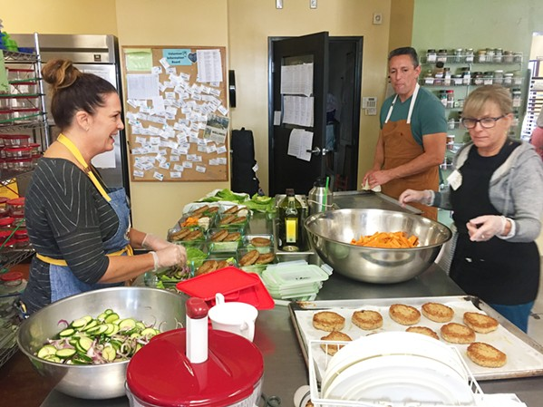 HEALING THROUGH THE KITCHEN Volunteers work daily at The Wellness Kitchen and Resource Center to learn about and prepare healthy foods. - PHOTO COURTESY OF THE WELLNESS KITCHEN AND RESOURCE CENTER