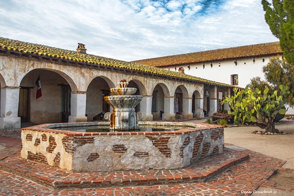 CALIFORNIA HISTORY North County photographer Dean Crawford often uses various filters when capturing images like this one of Mission San Miguel in order to give the piece a surreal look. - PHOTO BY DEAN CRAWFORD