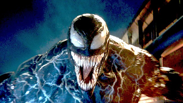 SMILE FOR THE CAMERA When a journalist bonds with an alien symbiote, the result is Venom, a powerful hybrid creature played by Tom Hardy in Venom. - PHOTO COURTESY OF COLUMBIA PICTURE CORP.