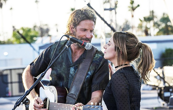 STAR POWER A seasoned performer near the end of his career (Bradley Cooper, left) discovers, nurtures, and falls in love with a talented newcomer (Lady Gaga), in A Star Is Born. - PHOTO COURTESY OF WARNER BROS. PICTURES