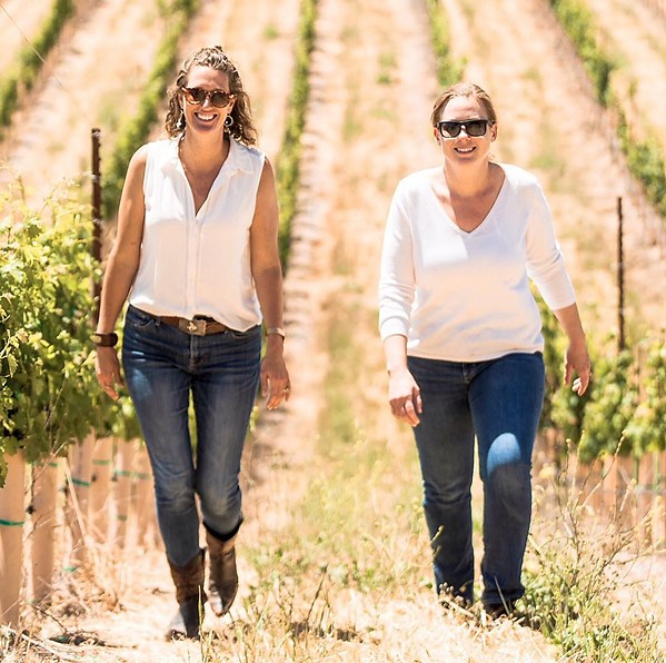 VINEYARD MEETING From left, Dream Big Darling founder and CEO Amanda Wittstrom-Higgins and a Los Angeles area wine buyer Sharon Coombs get some work done in the vines. - PHOTO COURTESY OF DREAM BIG DARLING