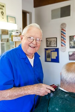 PAGE OUT OF HISTORY Dan Phillips has been cutting hair in his barber shop since 1961 and has watched Atascadero change through his front windows. - PHOTO BY JAYSON MELLOM