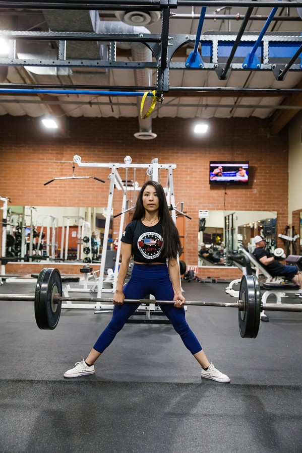 RAISING THE BAR Inside FitnessWorks of Morro Bay, Denise Juarez attempts a deadlift, one of the three lifts in powerlifting. - PHOTO BY JAYSON MELLOM