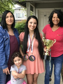 ALL ABOUT FAMILY Juarez poses for a photo with her grandmother (right), mother (left), and sister after winning top accolades at a competition in Santa Clarita last year. Juarez said she sometimes looks at a photo of her sister to inspire her before lifts. - PHOTO COURTESY OF DENISE JUAREZ