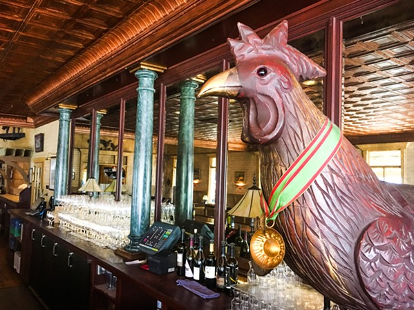 SUNDAY DINING A rooster and an empty restaurant greet attendees of a special brunch on Oct. 14 at McPhee's Grill, who head to the back room for food, drink, and a history lesson. - PHOTO BY CAMILLIA LANHAM