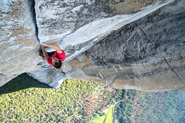 NO ROPES, NO SAFETY Free Solo documents climber Alex Honnold's solo ascent of Yosemite's El Capitan Wall—the first such climb and perhaps the greatest feat in climbing history. - PHOTO COURTESY OF NATIONAL GEOGRAPHIC