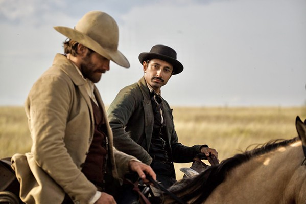 ON THE RUN Scout John Morris (Jake Gyllenhaal, left) takes chemist and budding prospector Hermann Kermit Warn (Riz Ahmed) under his wing, putting them both in the Sisters brothers' crosshairs. - PHOTO COURTESY OF ANNAPURNA PICTURES