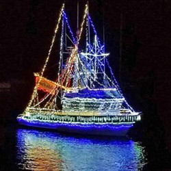 HOLIDAY AT SEA For 33 years, Morro Bay has been lighting up its waters with the Morro Bay Lighted Boat Parade during the first weekend in December. - PHOTO COURTESY OF TERI BAYUS