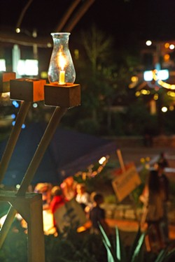 SPECIALLY MADE Old Mission Church Reverend Jim Nisbet and Congregation Beth David Rabbi Harry Manhoff joined forces more than 25 years ago to bring this menorah and a Hanukkah celebration to Mission Plaza. - PHOTOS COURTESY OF THE JCC OF SLO
