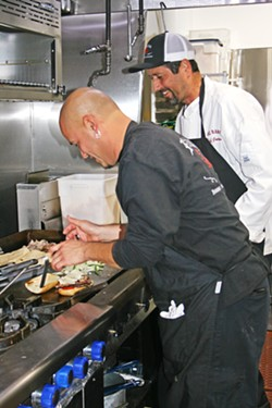 SOUL FOOD Rosalina Chef Mickey Lopez (foreground) and Executive Chef/owner Jeff Jackson play around with Mexican and American comfort flavors. - PHOTO BY HAYLEY THOMAS CAIN