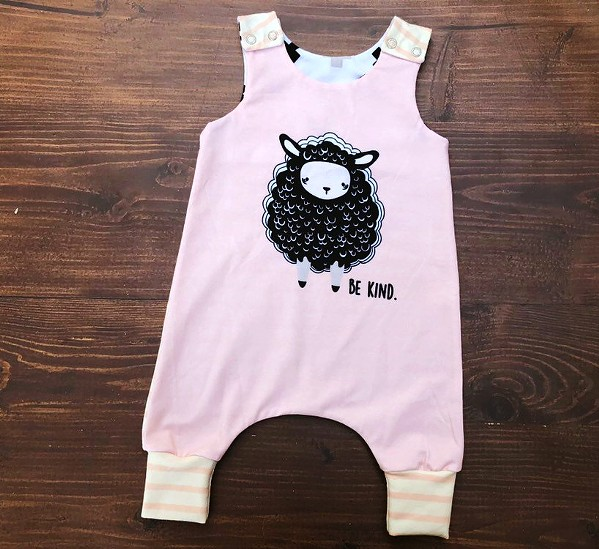 ONESIE Paso Robles resident Angela DiMauro handcrafts clothes, like this onesie, using organic fabric for infants and toddlers. Her pieces are available online under her moniker, Little Quills Clothing. - PHOTO COURTESY OF LITTLE QUILLS CLOTHING