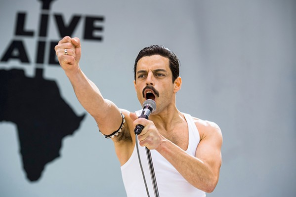 TRIUMPHANT RETURN After leaving Queen for an ill-fated solo career, Freddie Mercury (Rami Malek) and Queen re-formed in time to play the historic 1985 Live Aid concert. - PHOTO COURTESY OF NEW REGENCY PICTURES