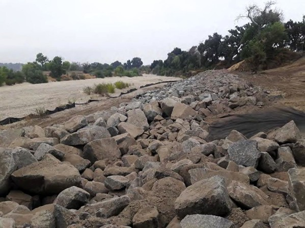BOLSTERED More than 10,000 tons of granite was installed along a section of the Salinas River bank that was eroding and threatening a critical Paso Robles city wellfield. - PHOTO COURTESY OF THE CITY OF PASO ROBLES