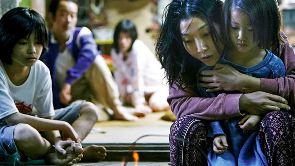 DOMESTIC DRAMA A poverty-stricken family takes a child into their home after finding her outside in the cold and noticing signs of abuse, in Shoplifters. - PHOTO COURTESY OF GAGA PICTURES