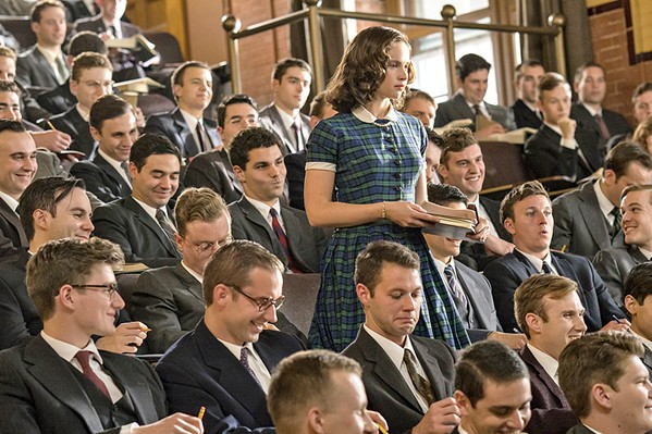 STAND UP AND STAND OUT Felicity Jones (standing) stars as Ruth Bader Ginsburg, who made her early career about fighting for equality. - PHOTOS COURTESY OF AMBLIN PARTNERS