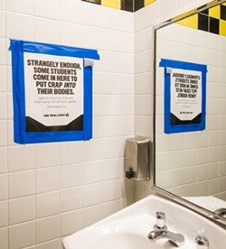 SIGN OF THE TIMES San Luis Obispo High School recently started putting signs like these in the bathrooms as part of an effort to deter students from using electronic cigarettes. - PHOTO BY JAYSON MELLOM
