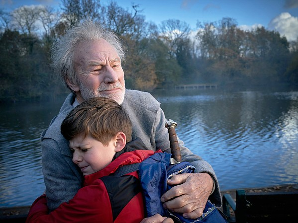 BE SOMEBODY Merlin (Sir Patrick Stewart) helps Alex (Louis Ashbourne Serkis) fulfill his destiny, in The Kid Who Would Be King. - PHOTO COURTESY OF BIG TALK PRODUCTIONS