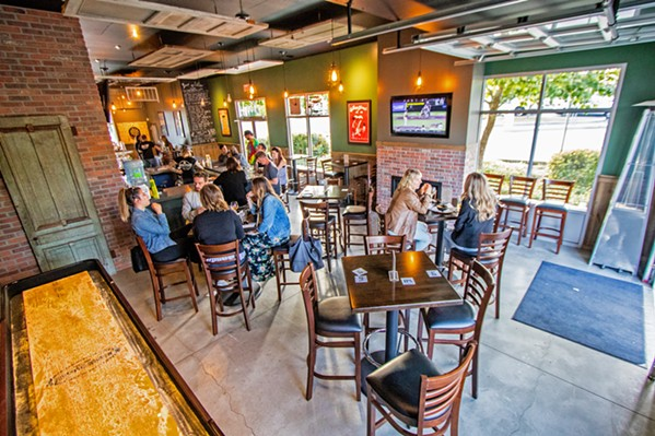"""CROWD PLEASING Craft beer, nachos, and old-school video games? Very few would say """"no"""" to this good-time trio, on tap now at Broad Street Public House. The new hangout is located at 3590 Broad St. in San Luis Obispo. - PHOTOS COURTESY OF BROAD STREET PUBLIC HOUSE"""
