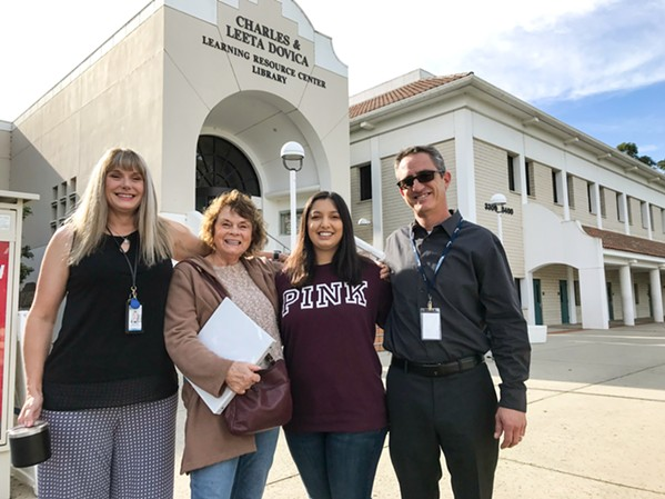 CHASING DREAMS Third-year Cal Poly student Ashley Romero (center right), 23, who has cerebral palsy, is helping adults with disabilities find their paths as an instructional aide at Cuesta College. Here, she's posing with Joey Carroll, a Tri-Counties Regional Center employment coordinator; Carol Lopes, a Cuesta College instructor; and Jeffrey Waggoner, a PathPoint employment specialist (left to right). - PHOTO BY PETER JOHNSON
