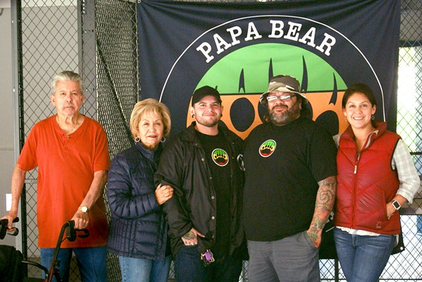"""FAMILY BUSINESS Alfred Castaneda, Irene Castaneda, Shay Zepeda, Andy """"Papa Bear"""" Zepeda, and Rachel Salerno are getting ready to start Papa Bear's Fine Cannabis and Better Living Delivery in SLO County. - PHOTO BY AIDAN MCGLOIN"""