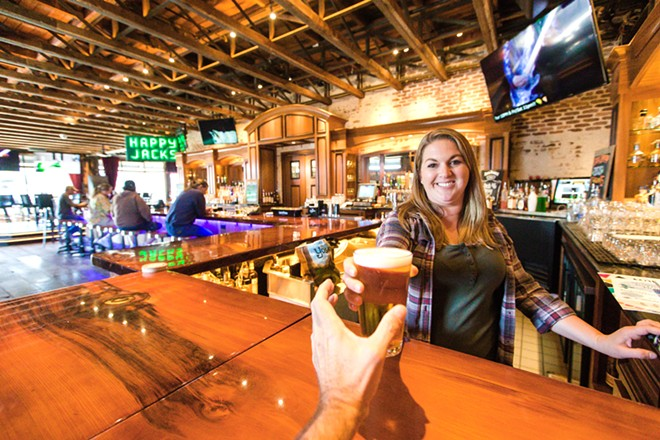 HIP AND HAPPENING Bartender Jessica Doyle serves up a cold one at the best North Coast bar in the county, The Siren in Morro Bay. - PHOTO BY JAYSON MELLOM