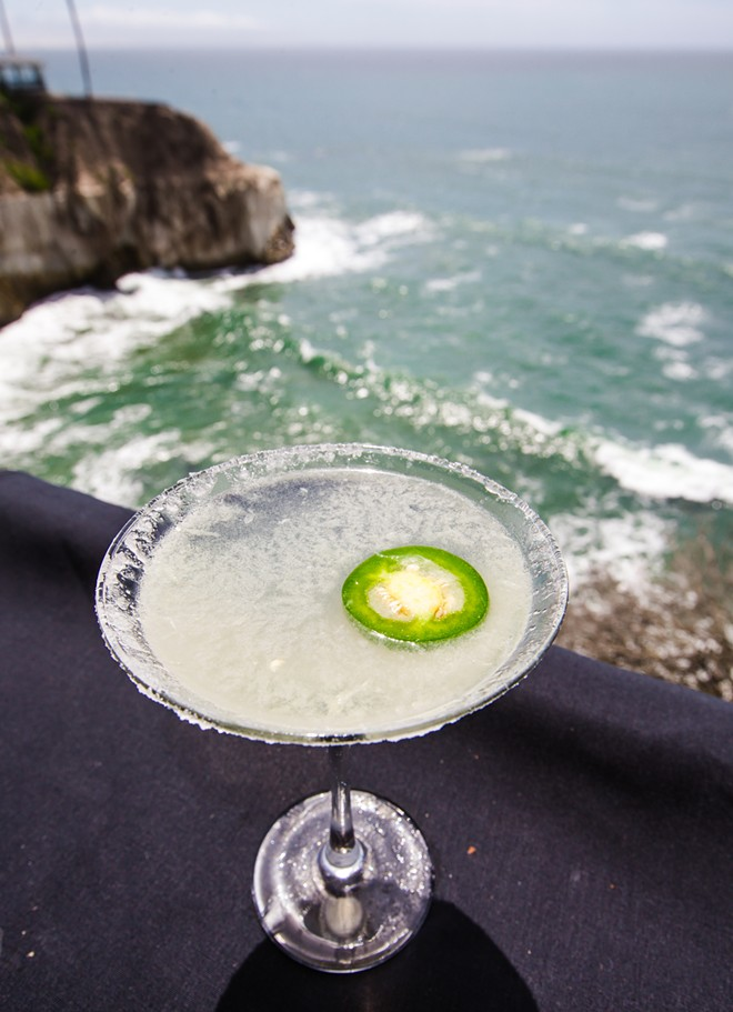 DRINK IT IN A jalapeño margarita enjoys one of the best views in the county, from the Ventana Grill deck, perched above the Pacific in Pismo Beach. - PHOTO BY JAYSON MELLOM