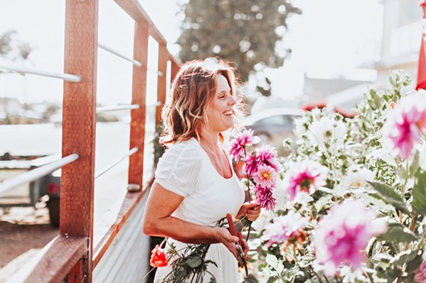 GARDEN OF EDEN Rachael Manuele (pictured) turned her passion for nature into a career with the creation of her fine art floral design company, Eden Floral. - PHOTOS COURTESY OF ALEXANDRA WALLACE