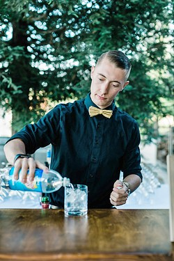 FAMILY THAT POURS One of best parts of Joslin's job is creating a bartending family that love to work with one other and interact with wedding attendees such as Luke Wills (pictured). - PHOTO COURTESY OF  LEANA MYRA PHOTOGRAPHY