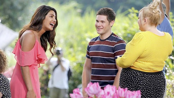 META ROM-COM (Left to right) Isabella (Priyanka Chopra), Josh (Adam Devine), and Natalie (Rebel Wilson) are all living in a romantic comedy, and Natalie loathes romance, in Isn't It Romantic. - PHOTO COURTESY OF BRON STUDIOS