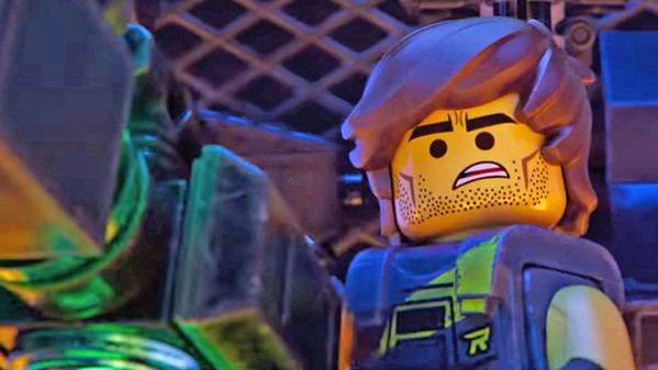 LEGO FACIAL STUBBLE?!? Rex Dangervest (Chris Pratt) comes to the rescue after Lego Duplo invaders from space attack, in The Lego Movie 2: The Second Part. - PHOTO COURTESY OF ANIMAL LOGIC