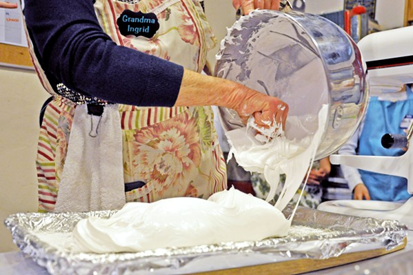 MIDDLE PRODUCT In a cooking demo during the Feb. 9 candy-making glass, Grandma Ingrid smooths marshmallow fluff into a baking sheet, where it will set. Depending on the size you want your finished mallow to be, she says, you can go with a taller dish. - PHOTOS BY CAMILLIA LANHAM