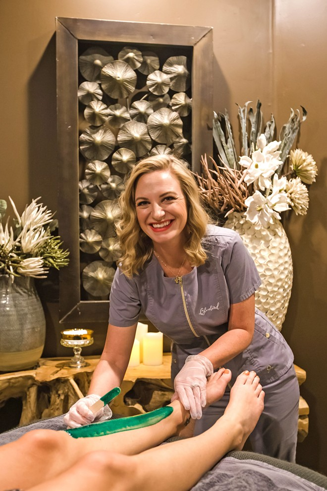 WAX ON, WAX OFF Morgan Parsons gets ready to rip that hair off as gently as possible at the Bluebird Salon—the best place for a cut, color, or wax. - PHOTO BY JAYSON MELLOM
